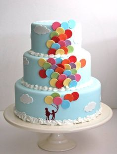 People holding balloons 3 tier cake