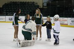 Bemidji State hockey cheerleaders with some young fans during Skate With the Beavers night.