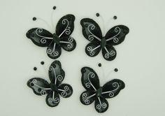 Sommerfugl 5cm Sort 5 stk. Smukke mellemstore håndlavede sommerfugle i bøjeligt ståltråd, dekoreret med glitter og sten - ikke 2 er helt ens.