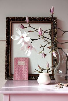 I like the idea of frames with a sheet of color, maybe a small image in the middle, next to a flower vase. Interior design, soft pink.