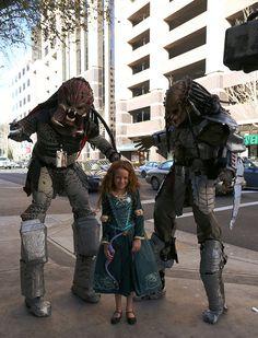 Predators from the Aliens vs Predator movie series, with Merida from the American Pixar movie Brave