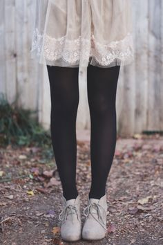 to try: cream polka dot dress/black tights/cream platforms