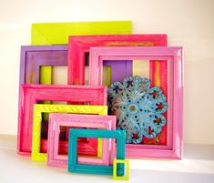 colorful frames- Spray paint dollar store or goodwill frames & use for trays, place card holders, & decor