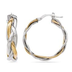 These statement hoop earrings feature two strands of 14k white gold braided together with one strand of 14k yellow gold, catching the attention of the room. Handmade in Italy.