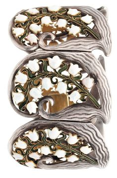Rare and important 'Lily of the Valley' bracelet. Composed of six major segments in silver with large finely carved scroll waves, each adorned with a branch of enamelled stem of Lily of the Valley, some flowers set with an opal . Signed René Lalique, circa 1895-1900.  #ArtNouveau #Lalique #Bracelet