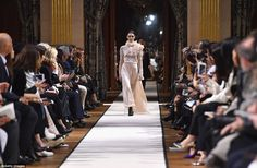 Grand entrance: The VIPs who scored coveted front row seats watched intently as the models...