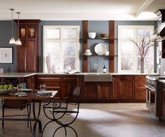 These Dark cherry kitchen cabinets have everything well stored, with features like wine bins and a lighted display, making for an elegantly casual kitchen.