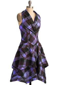 Purple plaid sundress... I like the daring of the brown and purple!