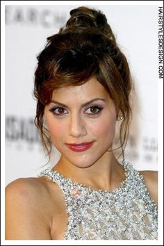 Details:  Hair Style: Want to look chic and classy on a night out? This updo style may be just the thing. Brittany Murphy has her long hair gathered all together high on top, taking the weight and the length off of the shoulders. The fringe is styled across onto the forehead with some hair at the sides, left loose.  Hair Cut: This haircut is long.  Hair Colour: Brittany's hair colour is dark brown with lighter highlights.  Suitable For:  Face shapes: oval, square, diamond  Hair texture…