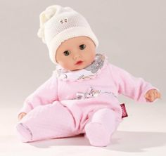 """Gotz Muffin 13"""" with Pale Pink Pajamas 2013 (Limited Edition) by Gotz. $42.74. This precious 13"""" Muffin baby doll comes with pale pink pajamas and a white wool hat.   Gotz dolls encourage creative and educational play. These dolls are high quality and meticulously crafted. All of their clothing, including button-holes, pockets, embroidery etc. is realistic and true to life. All materials used to make these dolls are tested according to strict guidelines and contain no..."""