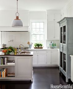 In a California kitchen, the vintage lights from the galley of a Dutch ship were the first thing designer Samantha Lyman and her client bought, and then they found the antique armoire in the same soft gray-blue.