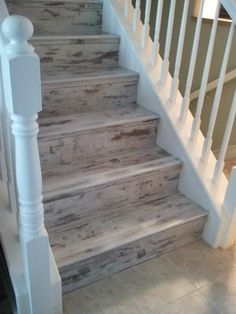 What a unique look!  One of our favorite projects/customers.  Details: Urban Loft - Whitewash by Earthwerks.  Custom made stair noses to match.  Perfect for that Island condo!