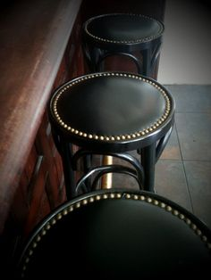 nailhead bar stool - simple painted bentwood stools with leather or pleather seats rimmed with nailheads - doable?  www.yournestdesign.blogspot.com