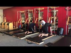 Pilates Tower class variations with the Roll Back Bar - YouTube