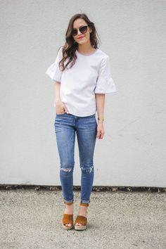 e84232a9d1c white ruffle sleeve + distressed denim. ripped jeans, white ruffle top, tan  espadrille