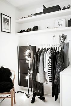 Place your clothing rack under accessory shelves for a cool retail store vibe