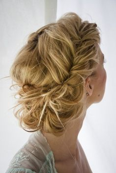 a Braided mess bun; Lovely hair for a relaxed bride. Messy has never looked so elegant!