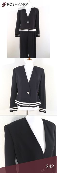 Ellen Tracy pant suit with white striped accents Excellent condition Ellen Tracy pant suit. The color is actually an extremely dark navy that is almost black. The contrasting white really makes this suit stand out. Extra button still sewn on inside. Size 12 blazer, size 10 pants. Jackets & Coats Blazers