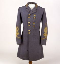 Confederate General's Frock Coat of Gen. Robert E. Lee as displayed by the Museum of the Confederacy. The Museum states this Frock Coat was the one that Lee wore to surrender negotiations at Appomattox in the parlor of the house owned by Wilmer McLean on the afternoon of April 9, 1865. Double breasted, made with English wool broadcloth. Four rows of gold bullion quatrefoil on each sleeve and General insignia of three stars encircled by a wreath on each side of collar.