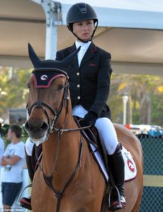 Heiress Georgina Bloomberg took part in a prestigious show jumping event with her horse Li...