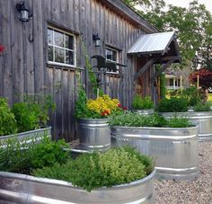Container Gardening Restaurants and home cooking / kitchen gardens take note: This idea would make for a great restaurant herb garden for added curb appeal as well as fresh, organic food appeal too!