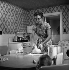CENTRALIA, Kansas—A woman preparing dough for bread, 1956.for Daily Bread  © Erich Hartmann / Magnum Photos TODAY'S PICTURE Patterns on the Wall