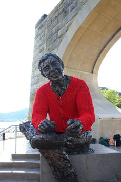 "Someone ""yarn bombed"" this statue, because if any statue should have a sweater, it's Mr. Rogers."