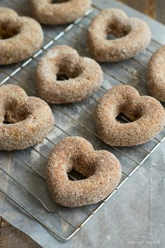 Baked apple cider donuts rolled in cinnamon sugar and topped with pomegranate glaze. Perfect for fall and so moist! Delicious Desserts, Yummy Food, Dessert Recipes, Spiced Cider, Apple Cider Donuts, Baked Apples, Vegan Dishes, Vegan Gluten Free, Dairy Free