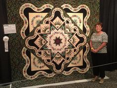 Glacier Star Queen designed by Quiltworx.com, made by Anna Bowen.  Her very first Quiltworx.com pattern was awarded an Honorable Mention ribbon at the 2015 Quilt Odyssey Hershey.