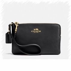 Coming Soon Coach Leather Wristlet Corner Zip Wristlet in CrossGrain Leather.  Black with Gold accent.  Zip closure.  Fabric lining.  Wrist strap. Coach Bags Clutches & Wristlets