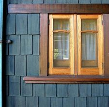 Time to paint our house! We just love the blue cedar shake with stained windows!!
