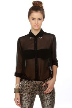 """There's boys already lining up just to see you in the Gentleman Collar Sheer Black Top! This already popular chiffon button-up gets just a little bit more desirable with stamped silver collar tips. Add long sleeves with button cuffs, and a breast pocket for the most sought-after look around! Unlined and SHEER. Model is wearing a size small. Small measures 27"""" long. 30"""" sleeve (from neckline). 36"""" waist. 38"""" bust. 100% Polyester. Hand Wash Cold."""