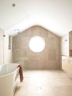 Luigi Rosselli Architects   Hill Top Cottage   round window limestone bathroom floor   © Justin Alexander