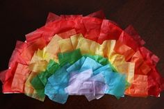 Paper Plate Rainbow Craft with Tissue Paper! An easy rainbow craft for toddlers. You'll learn a fun and nifty technique for drawing rainbows too!