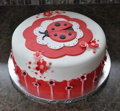 This ladybug cake was made to match the Modern Ladybug baby shower party decorations. Pumpkin spice cake w/ mini chocolate chips. Pumpkin pie cream filling and cream cheese frosting. I covered the cake with buttercream flavored fondant.