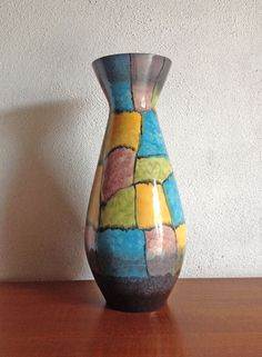 This is a very colourful, and cool West German ceramic vase. We love the patchwork design, and it's a big fella, measuring in at 50cm high.  Contact: Paul retrorumage@gmail.com