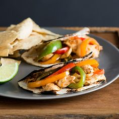 Chicken Fajitas with Bell Peppers | Red and orange bell peppers add a festive element to this classic fajita recipe. Feel free to toss in any other varieties you have on hand.