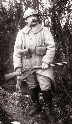 """WWI. French soldier with """"Mousqueton Winchester"""" M1894 .30-30 carbine c.1915~17.  The Winchester M94 was purchased in 1914 by the French army - along with many other modern American firearms throughout the war- to equip truck, plane and later tank pilots."""