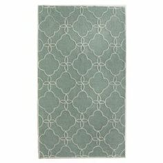 Add a pop of pattern to your living room or den with this hand-tufted rug, showcasing a quatrefoil motif in an ocean hue.    Product: RugConstruction Material: PolyesterColor: OceanFeatures: Hand-tufted Note: Please be aware that actual colors may vary from those shown on your screen. Accent rugs may also not show the entire pattern that the corresponding area rugs have.