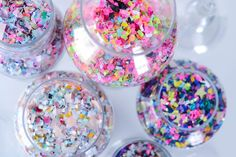 Fill an assortment of apothecary jars with pretty confetti as a bold, colorful, and easily adaptable decor piece! Confetti from The Confetti Bar