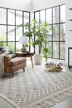 Discover Magnolia Home by Joanna Gaines area rugs, pillows, and throw blankets. Available at peaceloveanddecorating.com