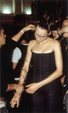 Corporeality For McQueen's Fall–Winter 1996–1997 show collection Leane made silver rose thorns which were stuck to the models' faces and thorn necklaces and bracelets that spiralled up the model's arm like rampant barbed wire. These...