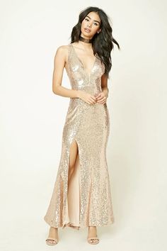 A knit maxi dress featuring allover sequin, a V-neckline, back cutout, side slit, and a concealed back zipper.