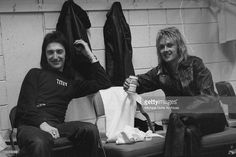 Bassist John Deacon (left) and drummer Roger Taylor of British rock band Queen backstage at the Montreal Forum, 26th January 1977.