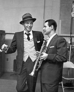 Frank Sinatra with a member from the band. Always with a cigarette in his hand. :)