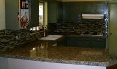 Kitchen Granite Tile Countertop and Glass Backsplash in Fort Collins Black Kitchen Countertops, White Granite Kitchen, Granite Countertops Colors, Kitchen Countertop Options, Best Kitchen Cabinets, Fort Collins, Titanium Granite, Backsplash Wallpaper, Outdoor Tiles