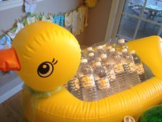 Sister in law's baby shower. Aqua  yellow. Duck theme. Inflatable duck as a cooler for the water! (Put ice in bags along the bottom) and labels for the water bottles courtesy of Etsy!