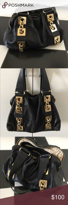 Michael Kors Purse Michael Kors Purse. Black leather with gold chain hardware on sides. Great condition! Michael Kors Bags