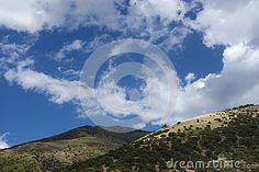 A view of a rural dirt road in the Sangre De Cristo Mountains in the high arid desert of Colorado. Low shrub scrub brush vegetation dotting the landscape Desert Mountains, State Of Colorado, Beautiful Landscapes, Shrubs, Fields, Deserts, Park, Outdoor, Image