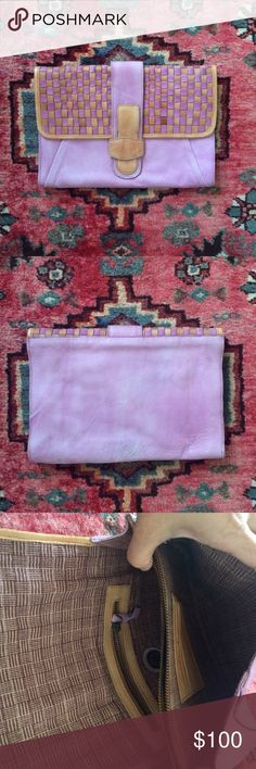 """Woven Clutch Lilac and natural/ orangish leather clutch. 3 compartments inside. Magnetic closure.  8"""" by 12"""". By Holding Horses. In great condition except for minor scratches  (last photo) Can list for less on ♏️erc Anthropologie Bags Clutches & Wristlets"""